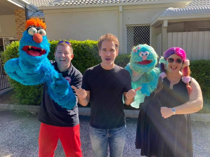 Puppet Show - Larrikin Puppets - Photo of Todd Sampson with Brett Hansen holding Troggg the puppet, left, and Elissa Jenkins holding Marina the puppet, right.